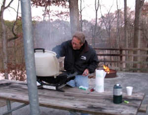 Ron grilling burgers
