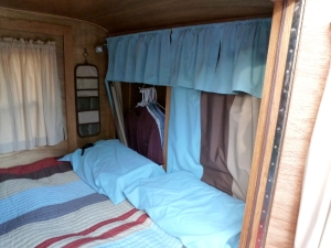 The front interior.  Each person has clothes storage space behind curtains.
