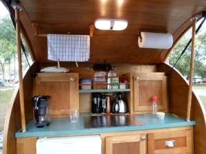 The teardrop's kitchen.  They removed the cooktop for extra counter space and now use a camp stove on the picnic table.