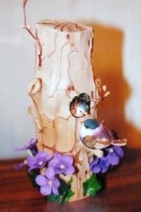 Birds nest in worm-eaten wild cherry log