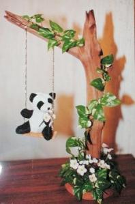 Panda on a swing