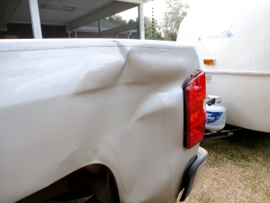 The left rear panel of the truck.  This damage is from the Casita's belly band.