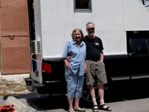 Margie and her husband in front of their homemade camper.  I didn't catch her husband's name.