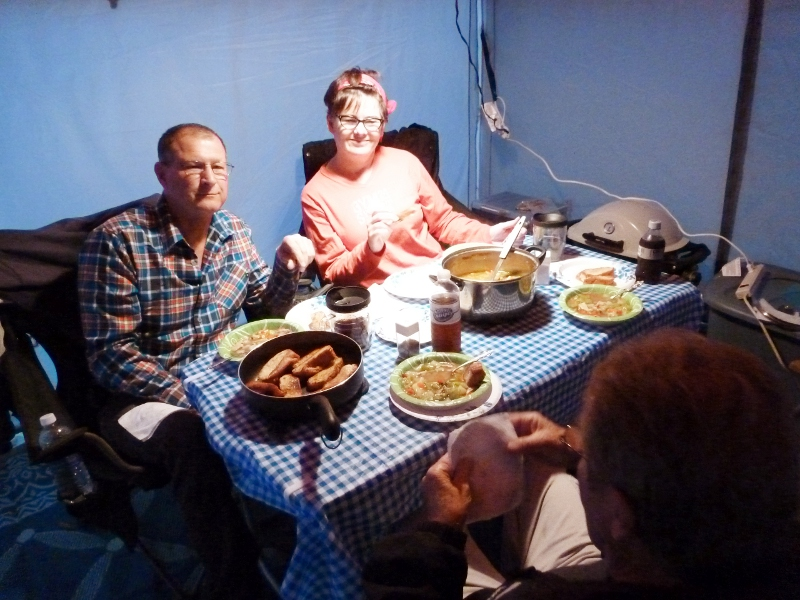 Jerry, Carla and Ron at dinner in Cozygirl's Paha Que screen room... complete with heater, good china (paper) and chandelier (shop light)  :D