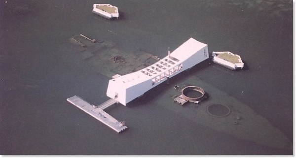 USS Arizona Memorial in Hawaii.  At Pearl Harbor, the USS Arizona suffered direct-hits from four 800-kg bombs dropped by high-altitude Japanese Kates and the remains of over 1,000 crewmen are still entombed in her hull. Even today, droplets of oil still leak to the surface. http://pearl-harbor.com/