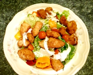 Chicken tenders in salad.