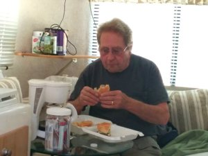 Ron digging into his 1/2 pound burger