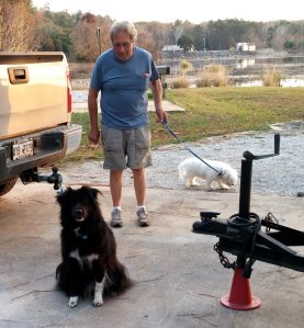 Welcoming committee.  Ron, Sheba and Sunny with dam in background.