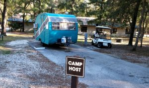 There are 6 camp hosts here.  The others have big rigs.  One has this little not-quite-restored vintage trailer.  :)