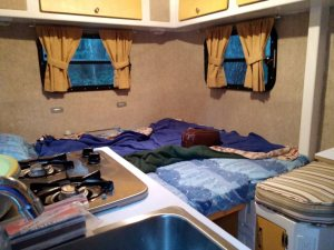 Large comfortable bed in the Park Liner, which can become another dinette.  I apologize for the color cast my camera gave it.