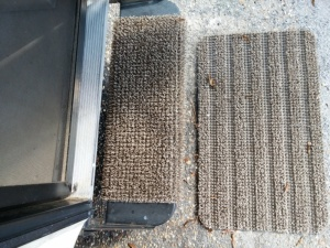 My new Camping World treasures -- a mud and sand scraping mat and stair cover.  Love them!