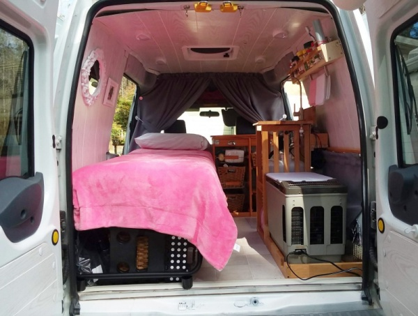 Interior view of small diy camper van from rear