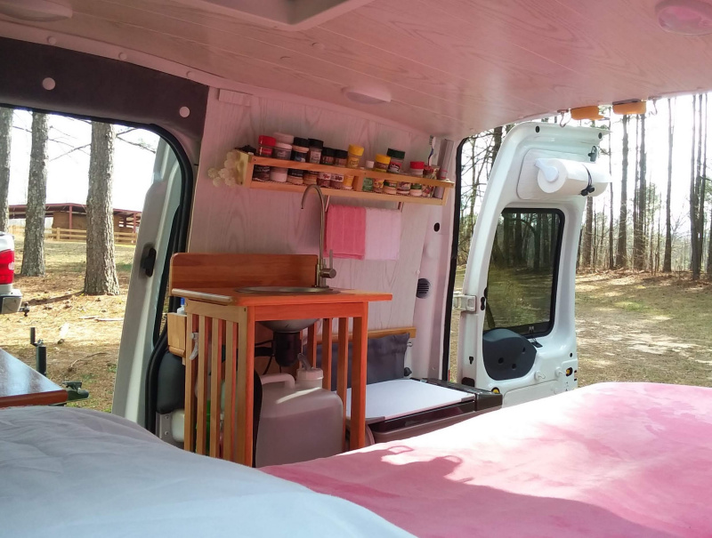 Kitchen view of tiny campers van interior