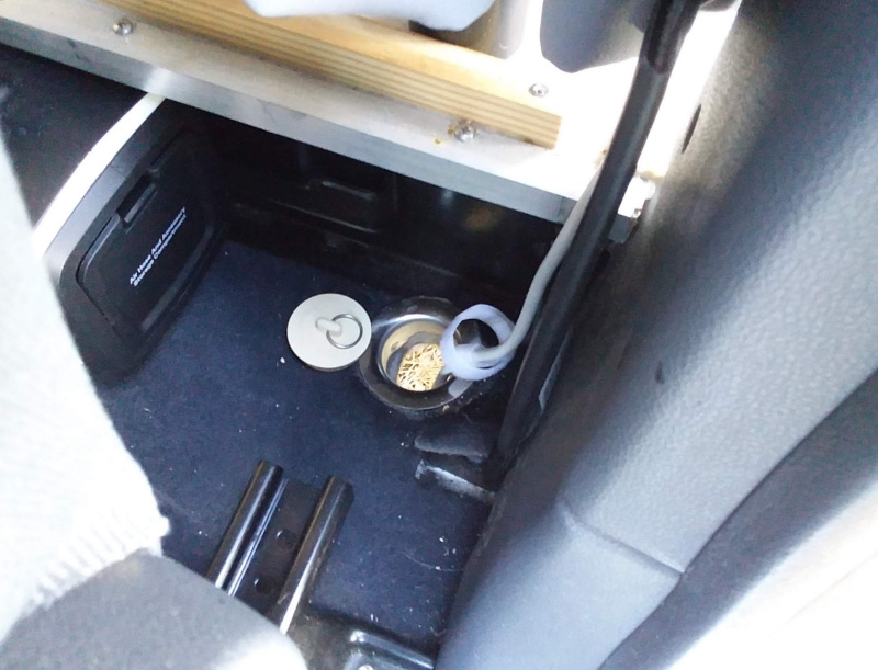 Hole in van floor for electrical cord